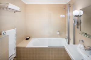 Een badkamer bij Boutique Hotel Seven Days