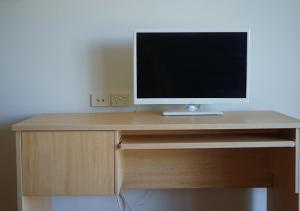 A television and/or entertainment center at Cabarita Studio