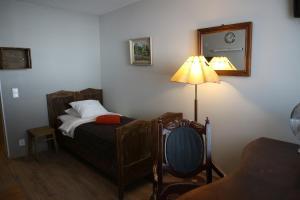 Säng eller sängar i ett rum på Majatalo Onnela