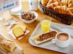 Options de petit-déjeuner proposées aux clients de l'établissement ibis budget Annemasse Geneve
