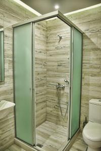 A bathroom at Artemis Hotel Apartments
