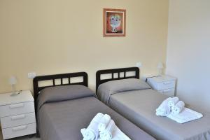 A bed or beds in a room at Cà Gardesana