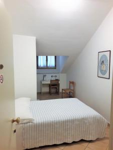 A bed or beds in a room at Affittacamere Parella