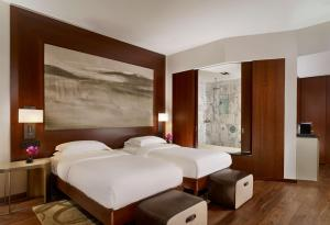 A bed or beds in a room at Park Hyatt Zurich