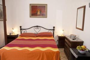 A bed or beds in a room at Villa Palumbo B&B