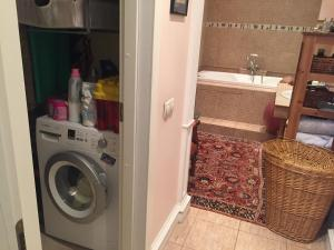 Ванная комната в Triumph Palace Apartment