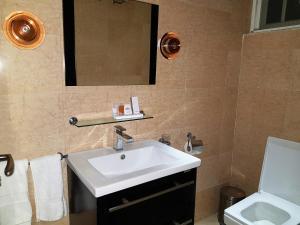 A bathroom at Serendib Hotel & Service Apartments
