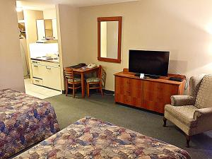 A television and/or entertainment center at Coastal Inn Dartmouth