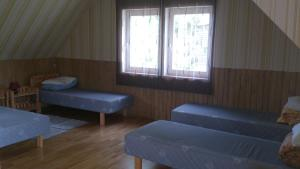 A bed or beds in a room at Järvesilma Tourism Farm