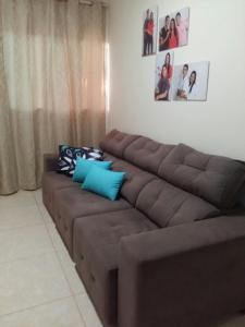 A seating area at Casa Nova Ótima Escolha