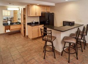 A kitchen or kitchenette at LivINN Hotel Minneapolis North / Fridley