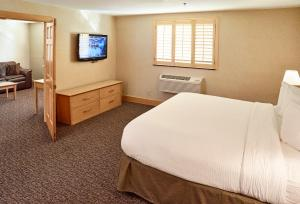 A bed or beds in a room at LivINN Hotel Minneapolis North / Fridley