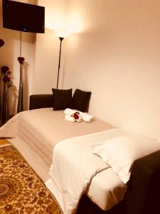 A bed or beds in a room at Corso 126 Guest House Salerno