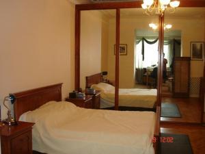 Cama ou camas em um quarto em Sahil Apartment