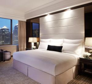 A bed or beds in a room at Singapore Marriott Tang Plaza Hotel (SG Clean)