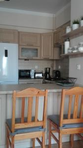 Kuchnia lub aneks kuchenny w obiekcie Apartament Boya