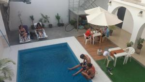 A view of the pool at La Maison de Lydia or nearby