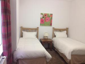 A bed or beds in a room at 2 Crescent Gardens Guest House