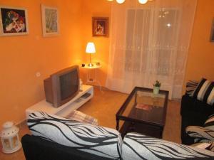 Una televisión o centro de entretenimiento en Casa Pipo Y Ceci