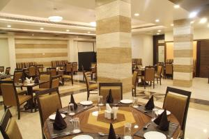 A restaurant or other place to eat at Amantra Comfort Hotel