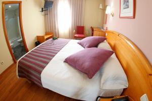 A bed or beds in a room at Maria de Luna