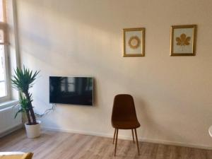 A television and/or entertainment center at City Centre Apartment Breda