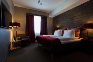Säng eller sängar i ett rum på Hotell Nordic