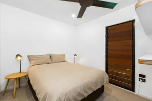 A bed or beds in a room at CABARITA BEACH HOUSE 53