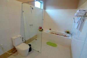A bathroom at Triumph Hotel Mandalay
