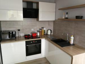 Kuchnia lub aneks kuchenny w obiekcie Apartament Mrągowo