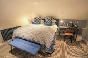 A bed or beds in a room at Christchurch Harbour Hotel & Spa