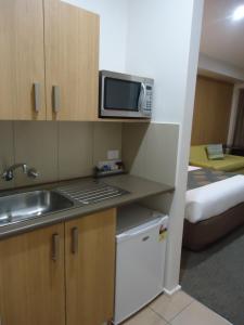 A kitchen or kitchenette at Albury Regent Motel