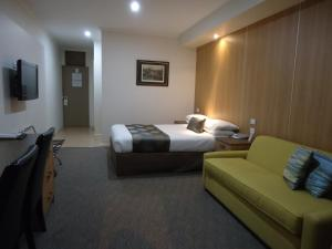 A bed or beds in a room at Albury Regent Motel