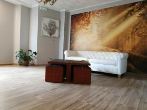A seating area at Hospedium Hotel La Marina Costa da Morte