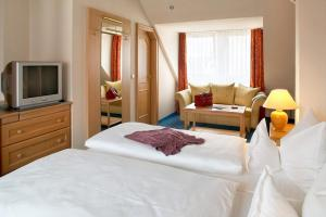 Ein Bett oder Betten in einem Zimmer der Unterkunft Hotel Mehl