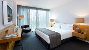 מיטה או מיטות בחדר ב-Hotel Royal Passeig de Gracia