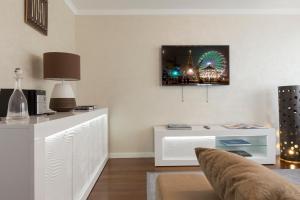 TV/Unterhaltungsangebot in der Unterkunft The Queen Luxury Apartments - Villa Vinicia
