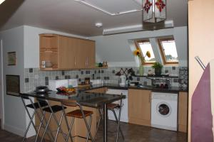 A kitchen or kitchenette at Muir Park Holiday Home