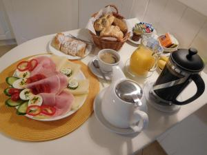 Breakfast options available to guests at Pension U Kapličky