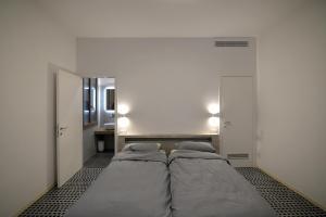 Letto o letti in una camera di Carbonaia Venezia