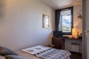 Un ou plusieurs lits dans un hébergement de l'établissement Au Pied Du Mont-Blanc - Chamonix