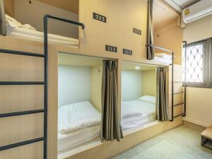 A bunk bed or bunk beds in a room at Sloth Hostel