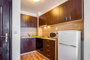 A kitchen or kitchenette at I love Varna Apartments