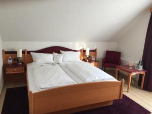 Ein Bett oder Betten in einem Zimmer der Unterkunft Akzent Hotel-Restaurant Albert