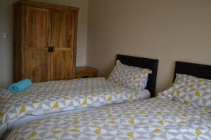 A bed or beds in a room at The Stratton Apartment