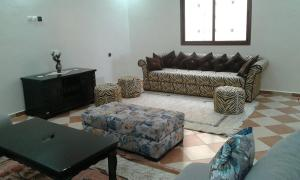 A seating area at Riad Le palais