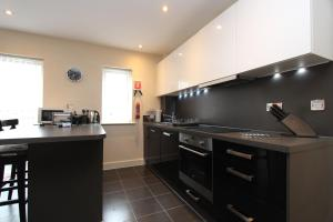 A kitchen or kitchenette at Heron House Luxury Apartments