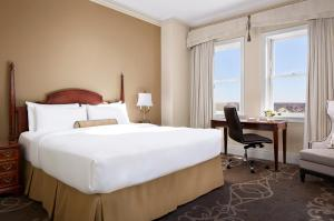 A bed or beds in a room at The Fairmont Hotel Macdonald