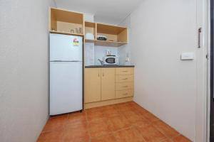 A kitchen or kitchenette at Belconnen Way Hotel & Serviced Apartments