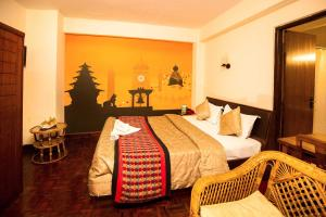A bed or beds in a room at Kathmandu Eco Hotel